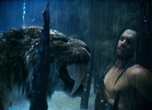 "scene from ""10,000 BC"" with Sabretooth Tiger growling at a hunter-gatherer"