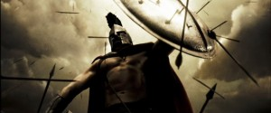 Screenshot from 300 of a Spartan with a shield full of arrows