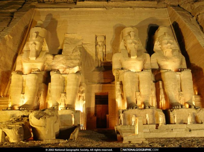 Four statues in a row of ancient egyptian pharaohs