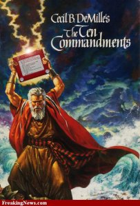 "The poster for the film ""The Ten Commandments"" with an Etch a Sketch instead of the two stone tablets held above Moses's head."