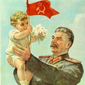 A propaganda poster of Stalin holding a baby with a Soviet flag