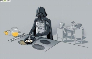 "Darth Vader cooking breakfast for little Luke and Lea, with an apron claiming: ""World's Greatest Dad"""