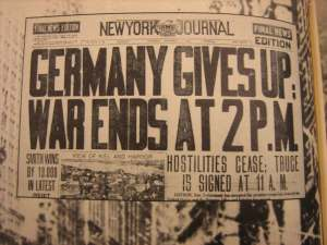 """Germany Gives Up - War Ends at 2 Pm"" - newspaper headline"