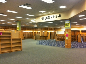 empty shelves, sign rearranged to: 'the end is near'