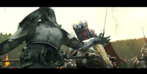 "A scene from ""Snow White and the Huntsman"" that shows the King slicing a soldier in half."