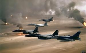 Kuwait Oil Fires seen from the air, with fighter jets flying above.