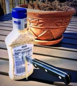 Caesar dressing bottle - with a knife through it...