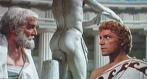 Alexander and Aristotle in front of a naked statue mooning them