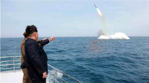Kim Jong-un watches missile launch